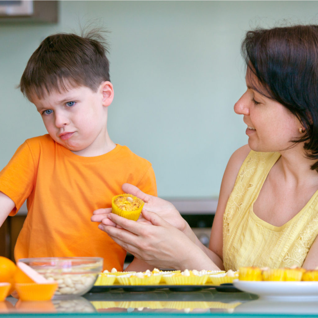 Mum tries to convince picky eater to try food